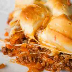 Sloppy Joe Biscuit Casserole is an easy ground beef casserole recipe loaded with French's fried onions, shredded mozzarella, cheddar and topped with Pillsbury biscuit pieces.