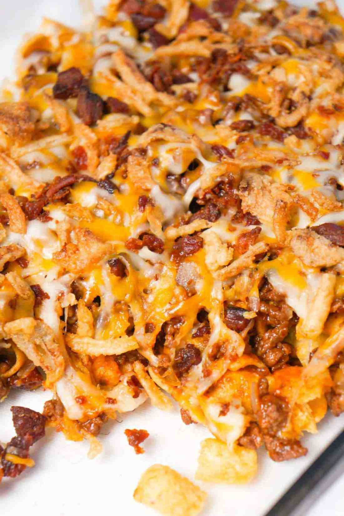 BBQ Bacon Cheeseburger Frito Pie is a delicous casserole with a base of Fritos corn chips, topped with ground beef and bacon crumble tossed in BBQ sauce, shredded cheese and French's fried onions.