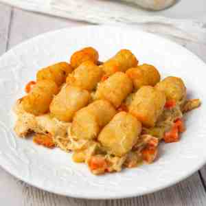 Chicken Pot Pie Tater Tot Casserole is an easy dinner recipe using shredded rotisserie chicken tossed with cream of chicken soup and mixed veggies all topped with tater tots.