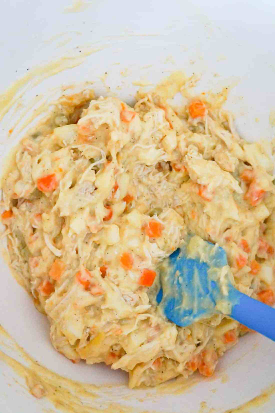 chicken pot pie filling in a mixing bowl