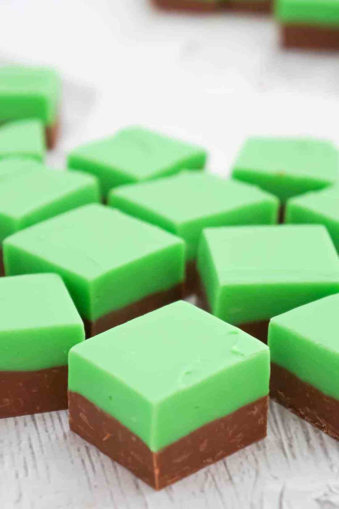 Mint Chocolate Fudge is an easy microwave fudge recipe using sweetened condensed milk, milk chocolate chips, white chocolate chips, green food colouring and mint extract.