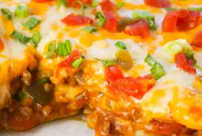 Taco Lasagna is an easy casserole recipe with layers of soft tortillas, shredded cheese, ground beef and salsa.