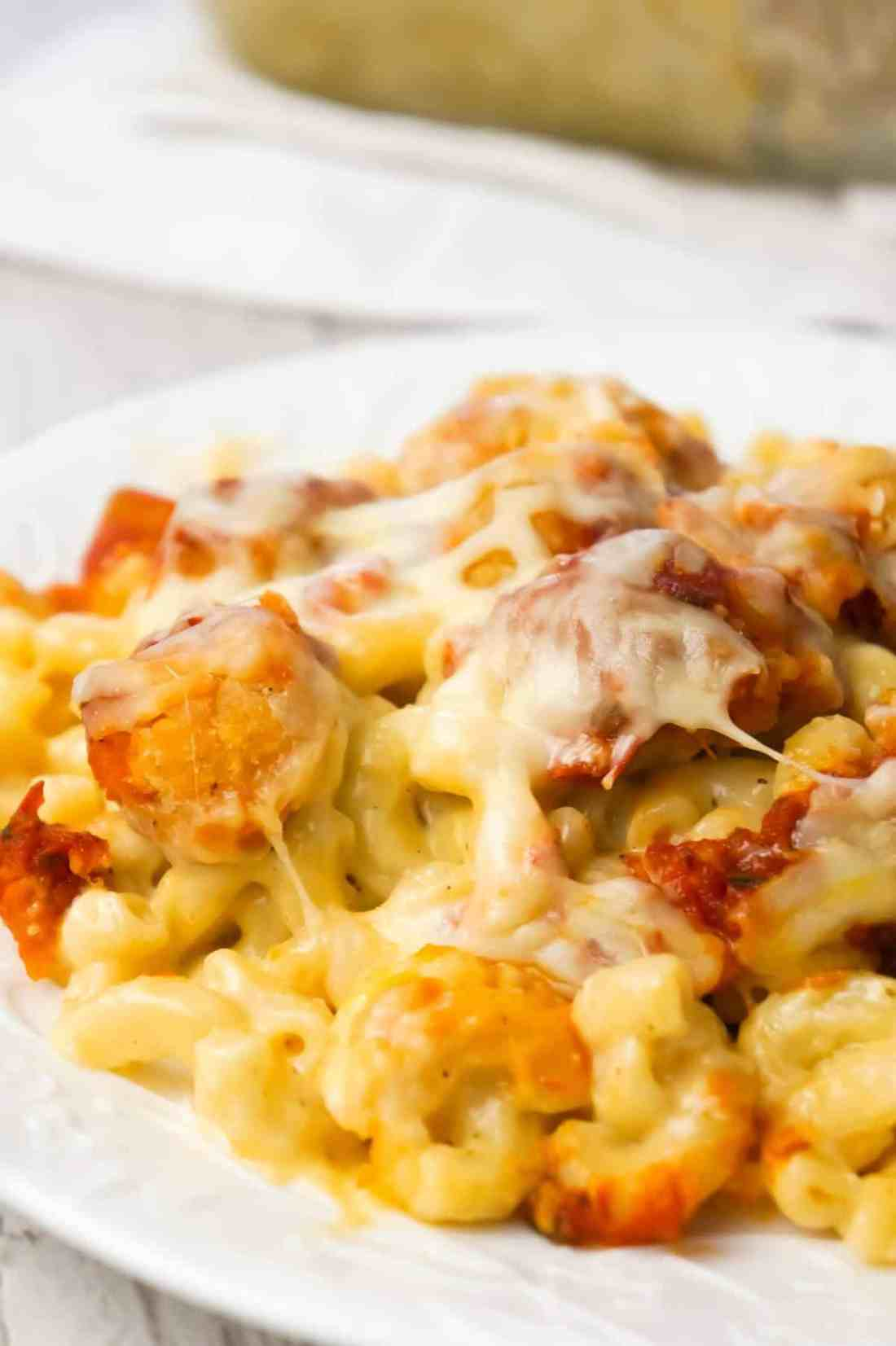 Chicken Parmesan Mac and Cheese is a hearty baked pasta recipe with a base of macaroni and cheese topped with popcorn chicken, marinara sauce and mozzarella cheese.