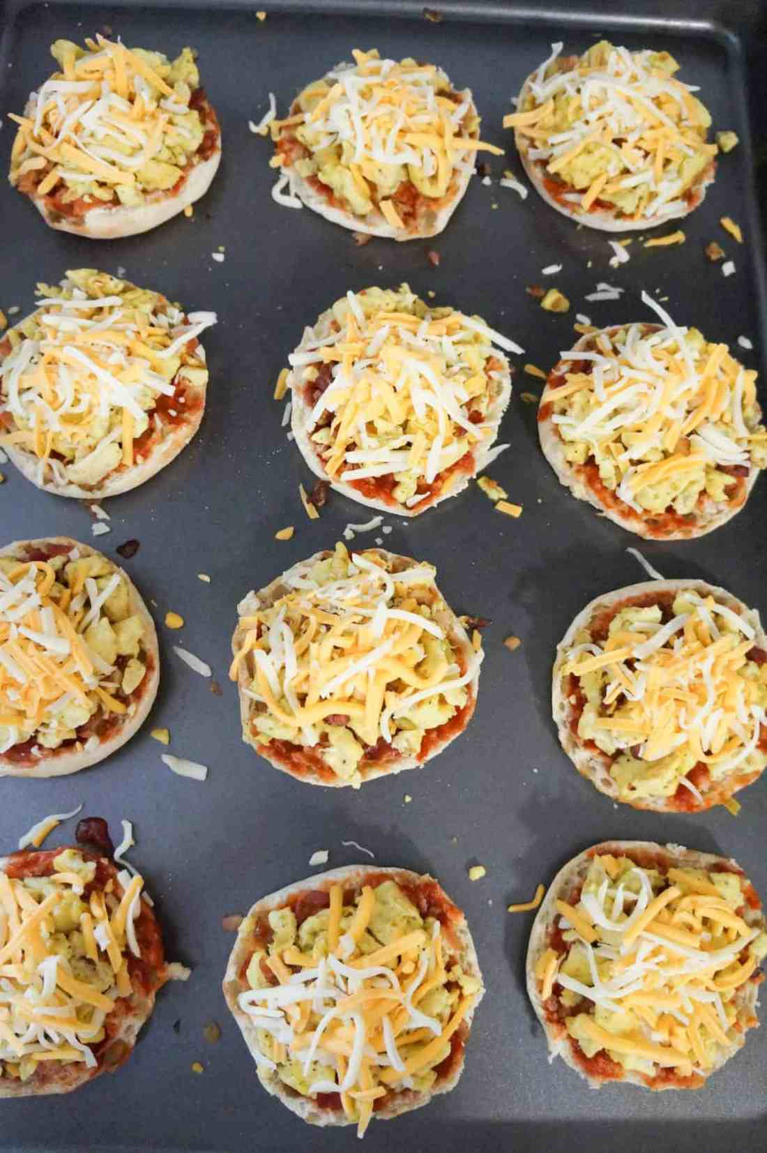 shredded cheese on top of breakfast pizzas before cooking