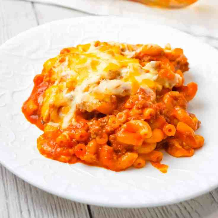 Baked Chili Mac and Cheese is an easy pasta recipe loaded with ground beef, tomato sauce, salsa and a shredded Tex Mex cheese blend.