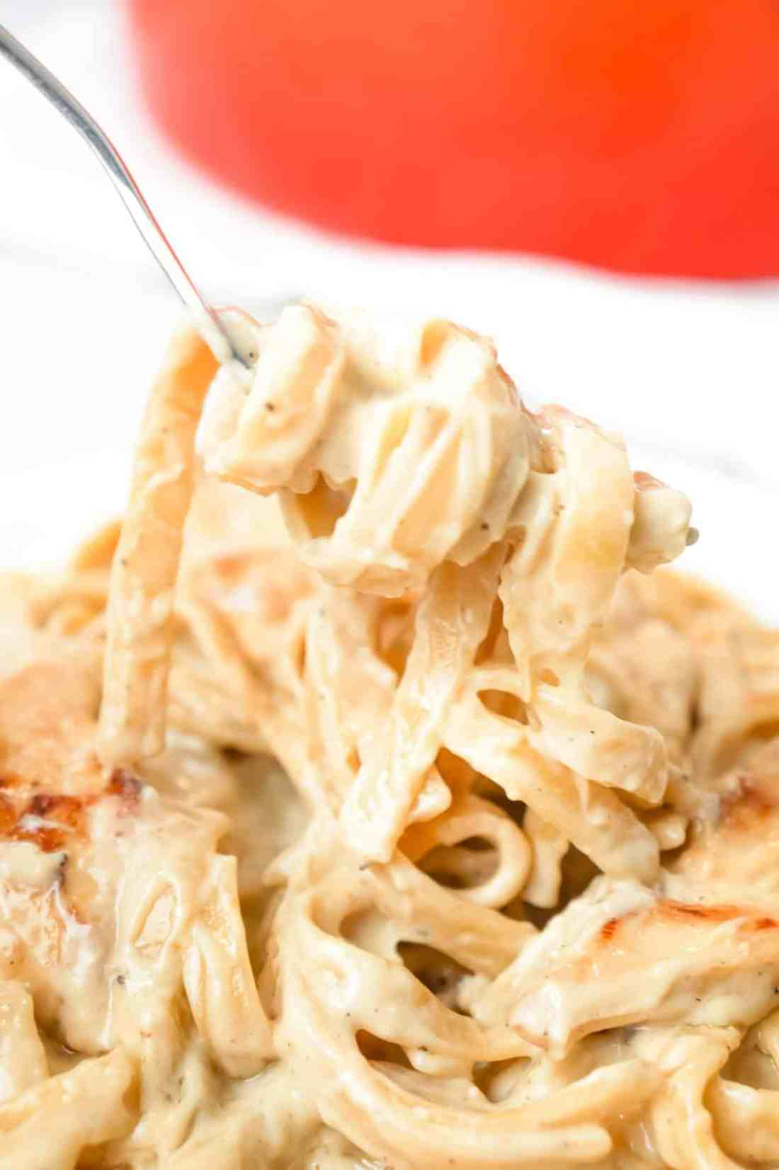 One Pot Fettuccine Alfredo with Chicken is an easy and delicious pasta recipe with a creamy garlic Parmesan sauce and loaded with slices of chicken breast.