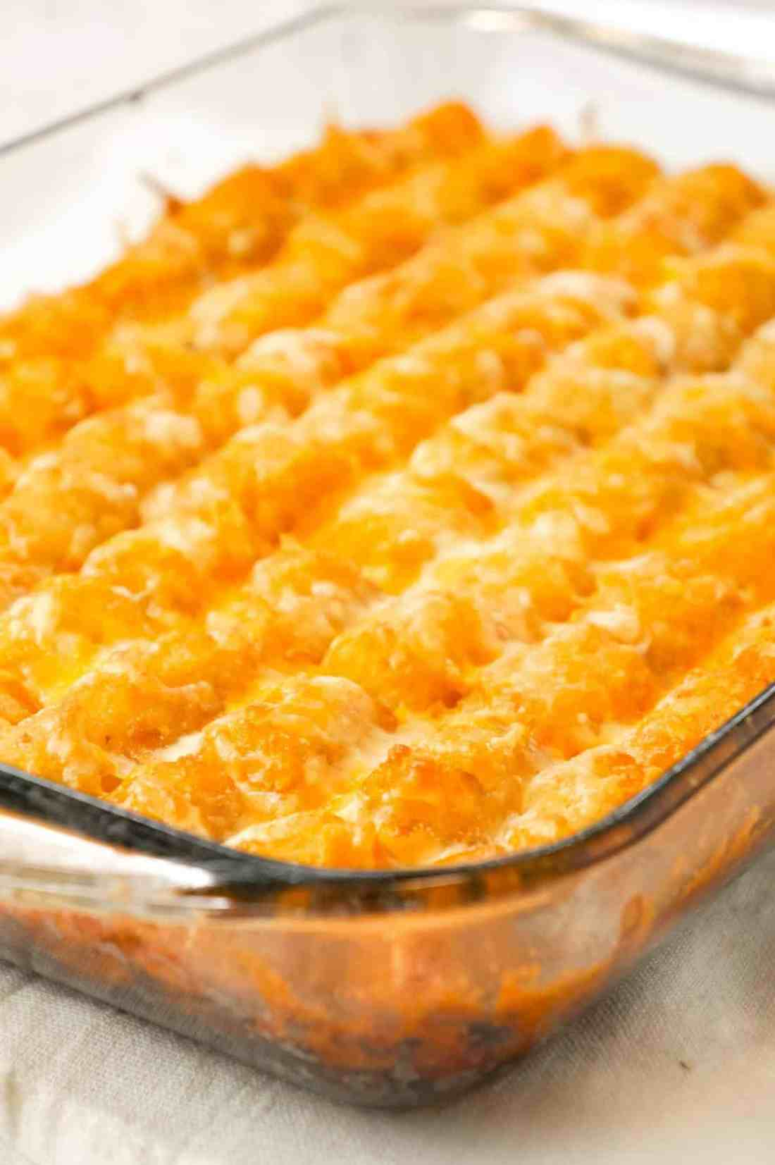 Sloppy Joe Tater Tot Casserole is an easy dinner recipe with a ground beef sloppy joe base, topped with cheese and tater tots.