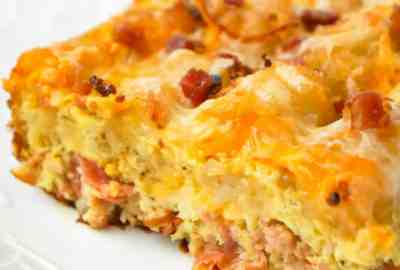 Tater Tot Breakfast Casserole is a hearty casserole recipe loaded with pork sausage meat, diced onion, chopped ham, crumbled bacon, eggs, shredded cheese and topped with tater tots.