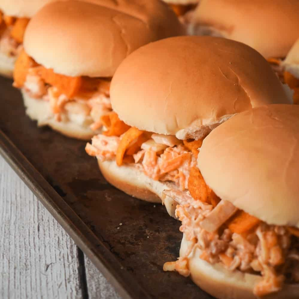 BBQ Fritos Chicken Sandwiches are an easy dinner recipe using shredded chicken and loaded with BBQ corn chips, cheddar cheese and bacon. This recipe is perfect for summer because if you use a grocery store rotisserie chicken you won't even have to turn on the oven.