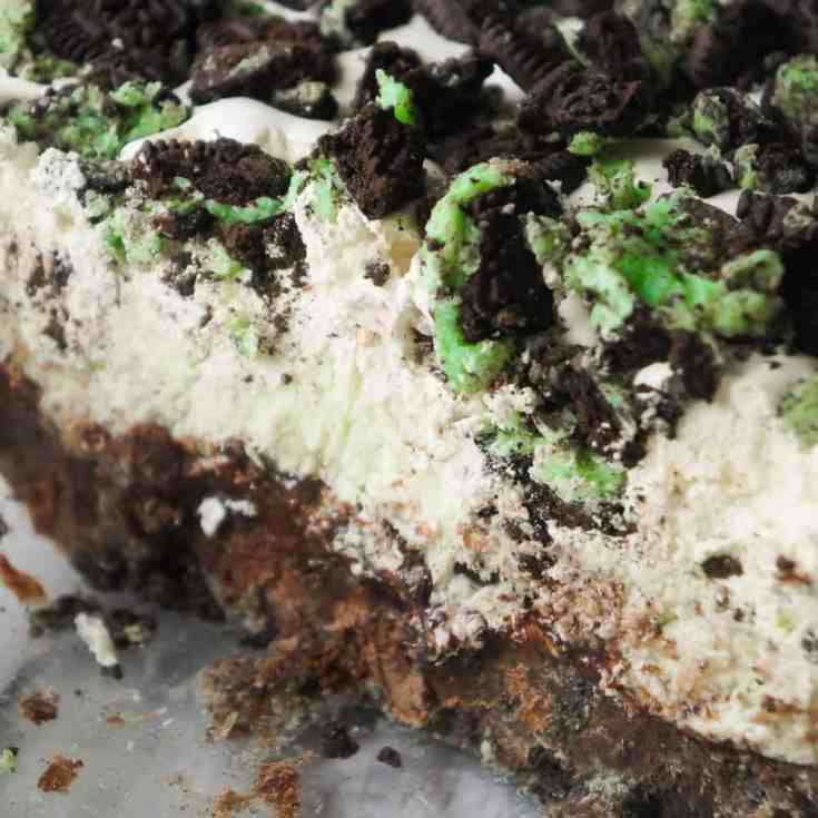 Mint Oreo Ice Cream Cake is an easy no bake dessert recipe perfect for summer. This mint chocolate chip ice cream cake is loaded with mint Oreo cookies, brownies, chocolate fudge sauce and Cool Whip.