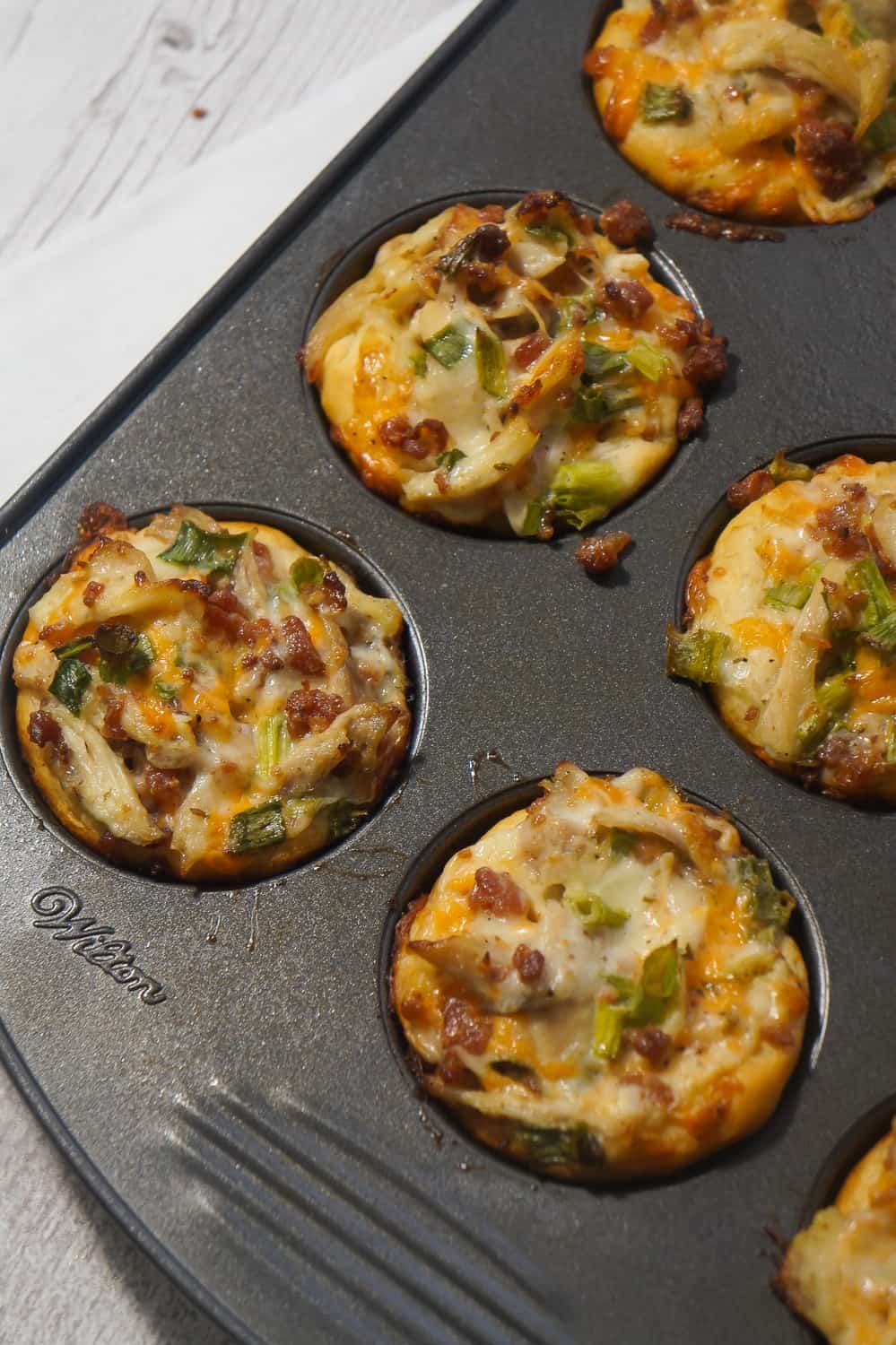 Chicken Bacon Ranch Biscuit Cups are a fun and easy party food. These biscuits loaded with rotisserie chicken, cheddar cheese and bacon are a delicious hand held snack.