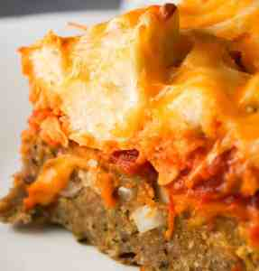 Easy Ground Chicken Casserole is a simple but delicious dinner recipe. The ground chicken base is topped with marinara sauce and cheesy garlic bread topping. This easy casserole is the best ground chicken recipe.