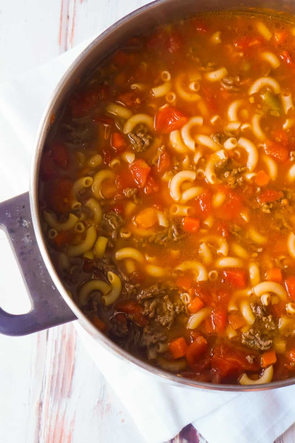 Easy Hamburger Soup with Macaroni is a hearty soup recipe that takes just fifteen minutes from start to finish.This delicious soup is loaded with ground beef, diced tomatoes, mixed vegetables and macaroni noodles.