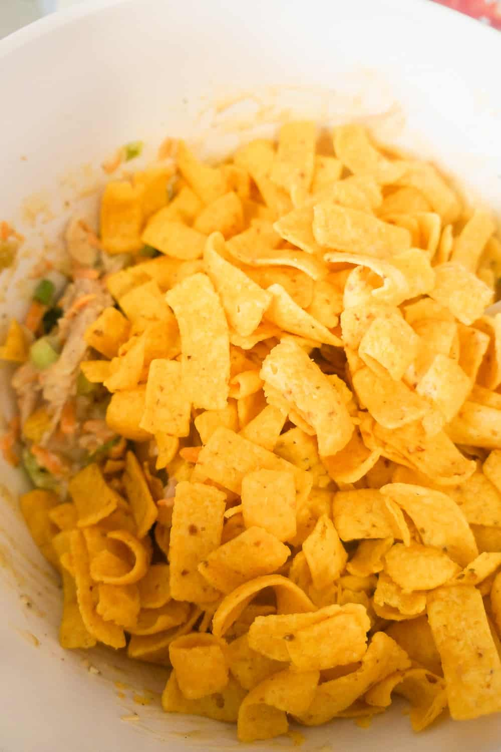 fritos and casserole filling in bowl
