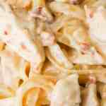 Instant Pot Bacon & Chicken Fettuccine Alfredo is an easy dinner recipe using an Instant Pot. This delicious pasta is coated in a creamy garlic Alfredo sauce and loaded with chicken and bacon.