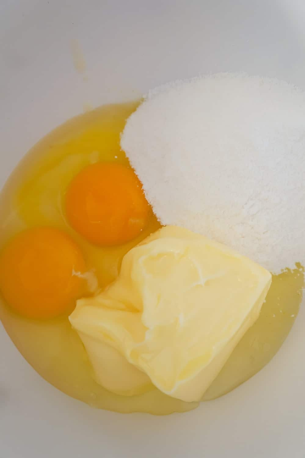 eggs, softened butter and lemon pudding mix in a mixing bowl