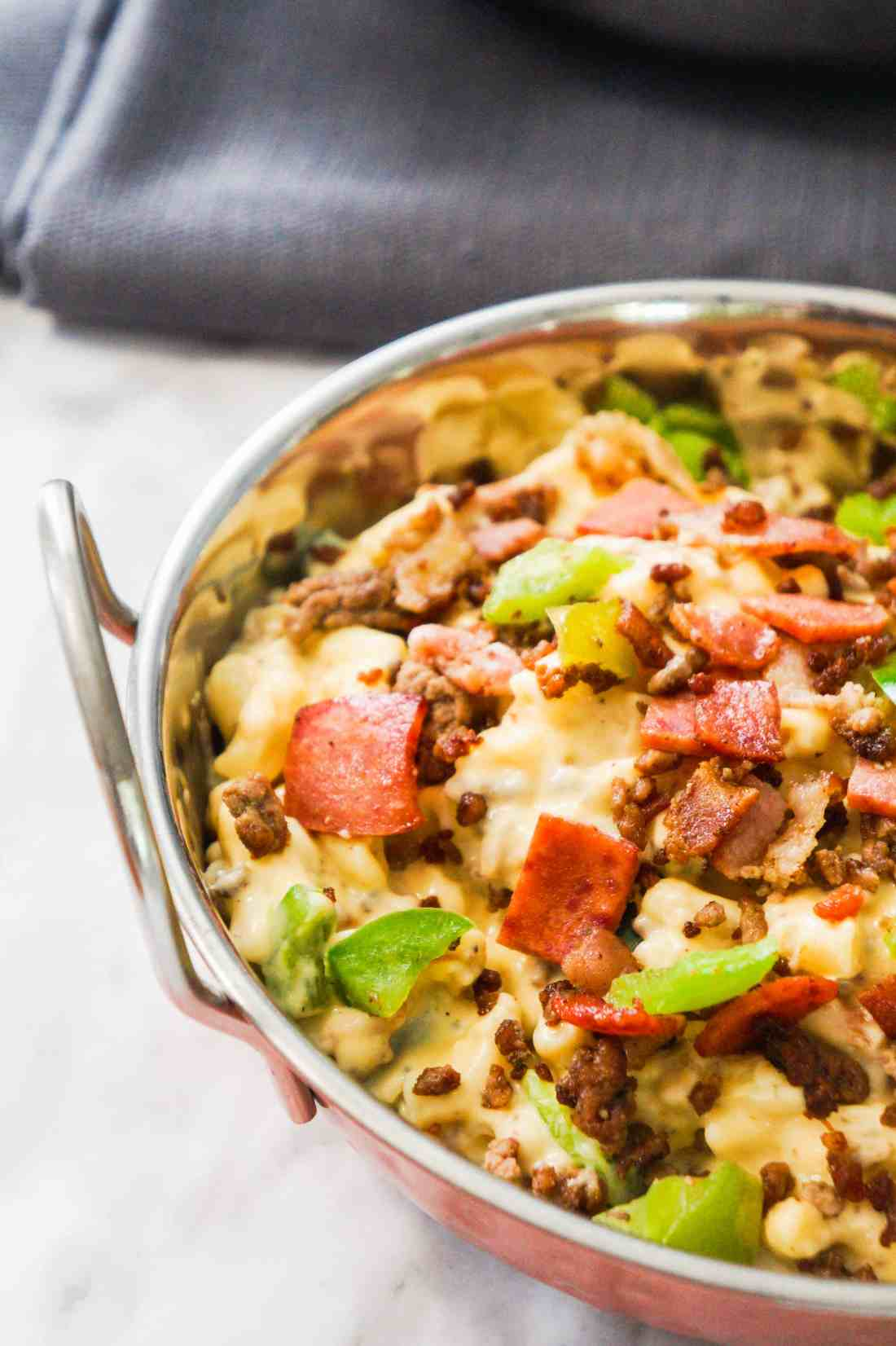 Meat Lover's Mac and Cheese. Easy homemade macaroni and cheese recipe loaded with ground beef, bacon, pepperoni and green peppers. Easy pasta dinner recipe.