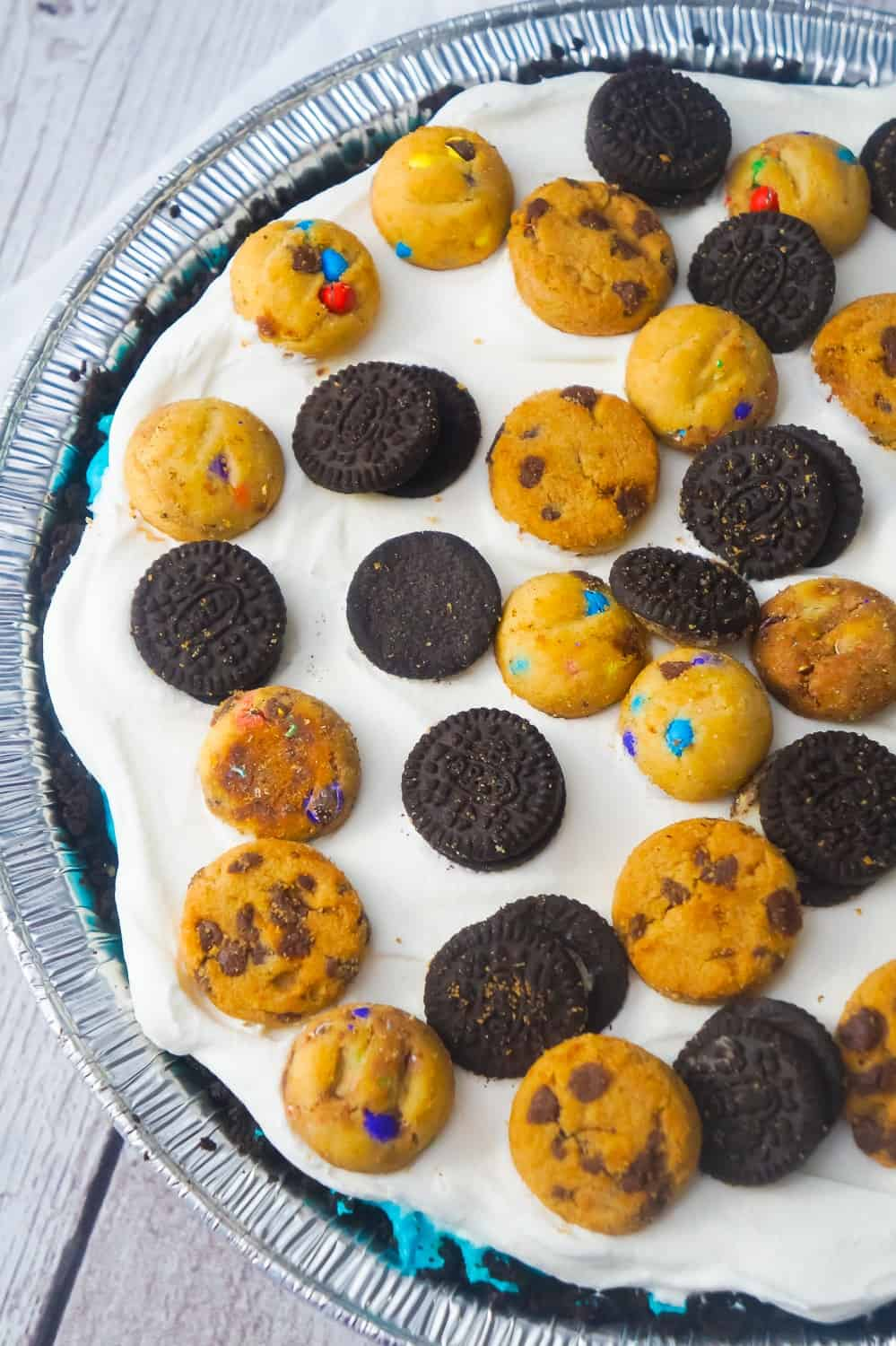 No Bake Cookie Monster Pie is an easy dessert recipe your kids will love.This colourful pie is made with instant pudding and Cool Whip in an Oreo crust and loaded with a variety of mini cookies.