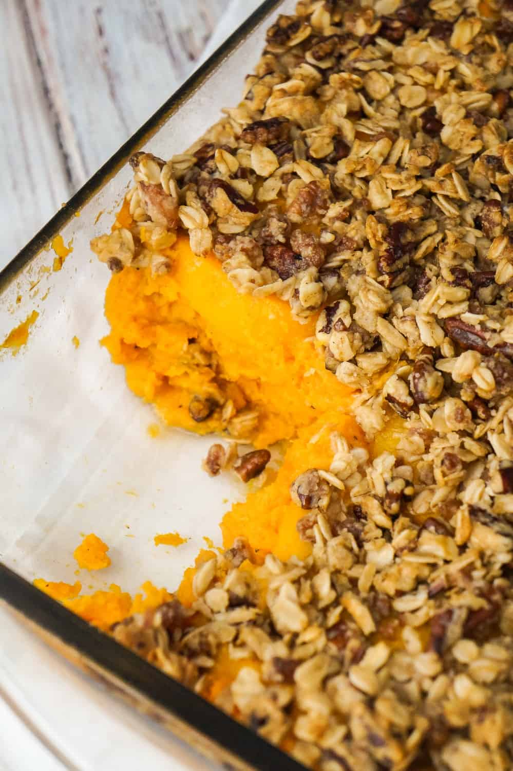 Sweet Potato Casserole with Peaches, Pecans & Bacon is the perfect side dish for a holiday dinner. Creamy mashed sweet potatoes are topped with sliced peaches and an oat crumble with pecans and bacon.