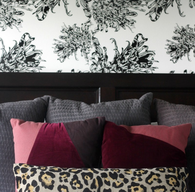 Chic wallpaper with berry colored and leopard print pillows | This is our Bliss | www.thisisourbliss.com