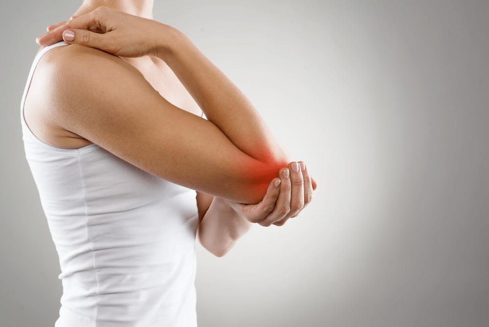 Girl nursing tennis elbow