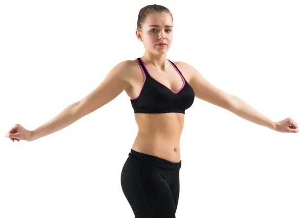 woman performing standing oblique twist