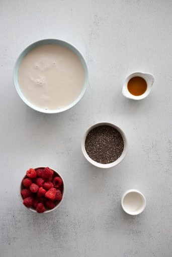Ingredients for chia seed pudding with macerated berries