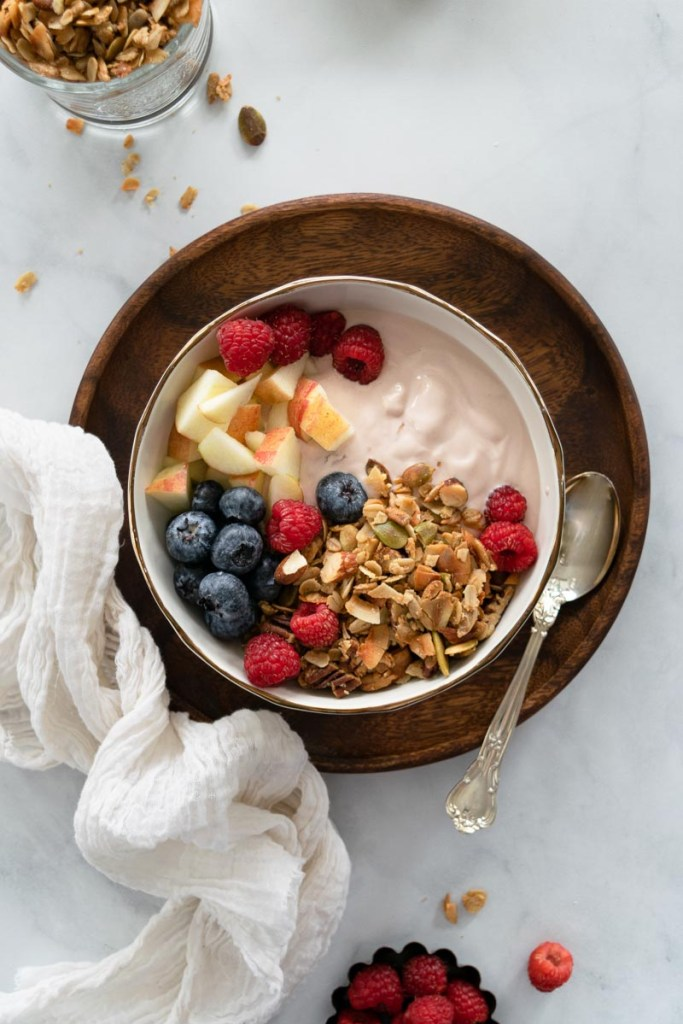 Granola in bowl with fruit and berries
