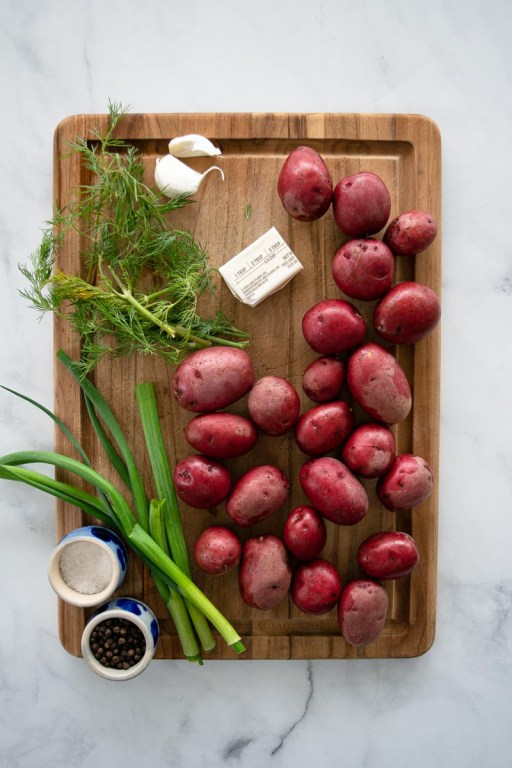 Ingredients for smashed potatoes with green onions and dill.