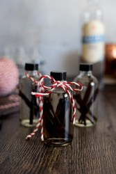 Homemade vanilla extract with a red and white ribbon