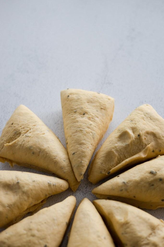 Closeup of sections of pretzel dough