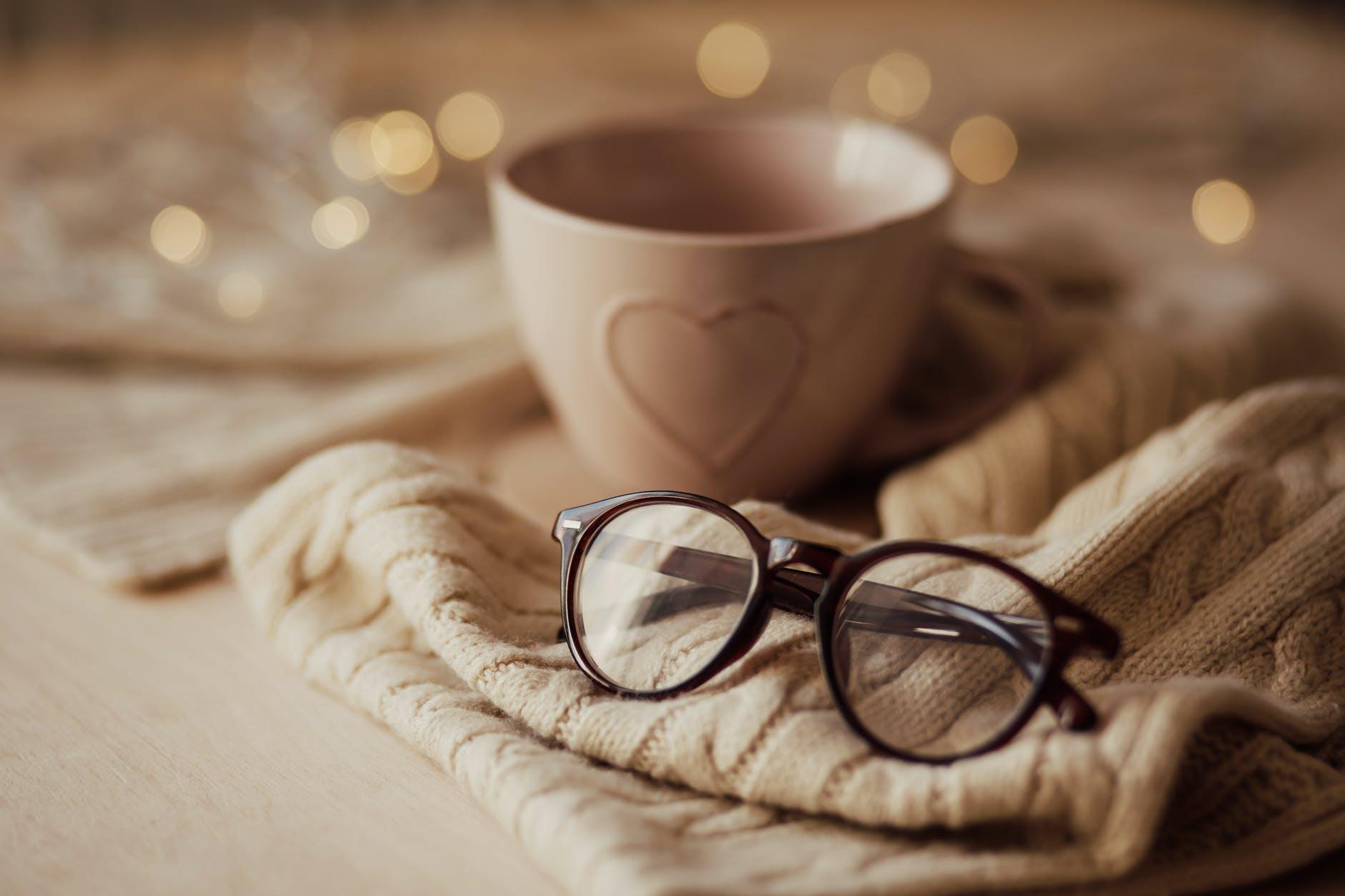 eyeglasses with mug on warm scarf