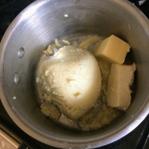 Cauliflower, butter, cream cheese, and heavy cream sitting in a saucepan