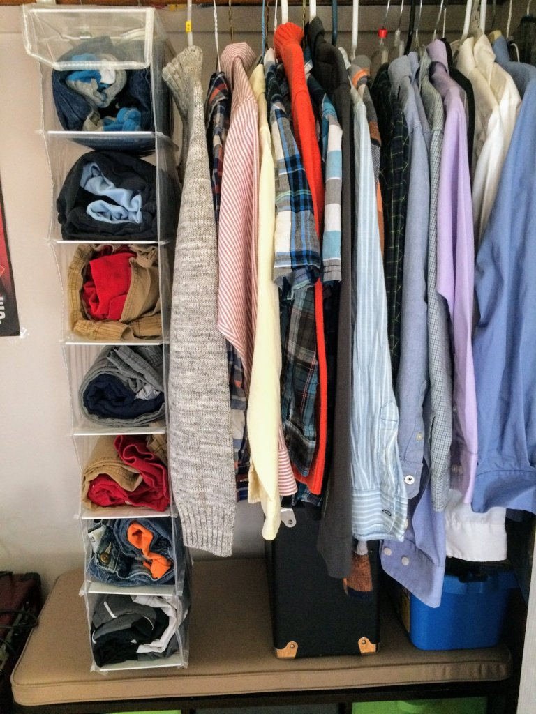 organizer for storing kids outfits hanging in closet