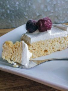 This low carb take on a traditional Tres Leches Cake is a real show stopper! A simple spongecake soaked in sweetened milk and topped with homemade whipped cream is sure to please everyone. Serve it topped with fresh berries, a dusting of cinnamon - or my favorite, frozen cherries! #keto #ketodessert #ketorecipes #tresleches
