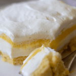 triple layer keto lemon dessert on a white plate
