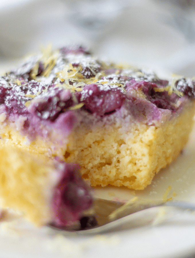 a close up shot of keto upside down lemon blueberry cake