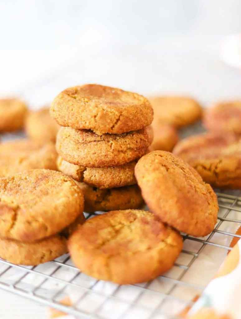 Keto pumpkin cookies stacked on a cooling rack