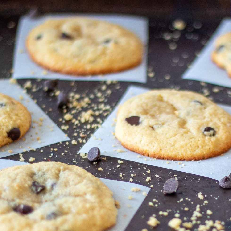 soft and chewy keto chocolate chip cookies on a baking sheet