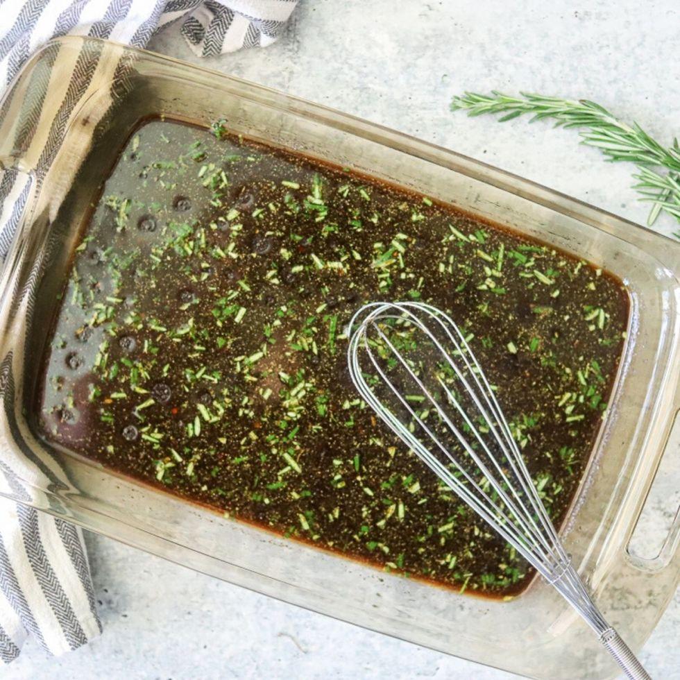 a shallow recatngular glass dish full of the best homemade steak marinade.