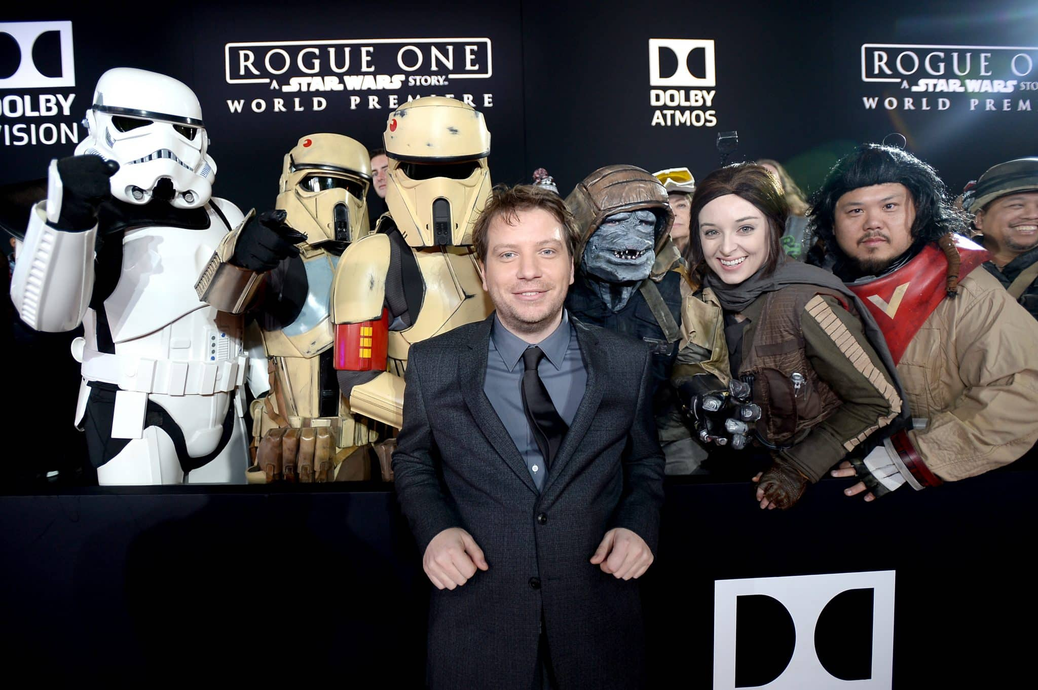 "HOLLYWOOD, CA - DECEMBER 10: Actor Gareth Edwards (C) poses with costumed fans at The World Premiere of Lucasfilm's highly anticipated, first-ever, standalone Star Wars adventure, ""Rogue One: A Star Wars Story"" at the Pantages Theatre on December 10, 2016 in Hollywood, California. (Photo by Charley Gallay/Getty Images for Disney) *** Local Caption *** Gareth Edwards"