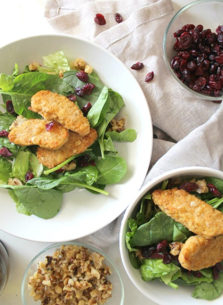 This Cranberry Candied Walnut Salad with Chick'n is the perfect vegan weeknight dinner - comes together in less than 30 minutes!   ThisSavoryVegan.com