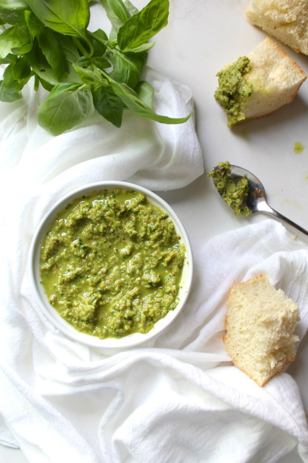 Step up your sandwiches with this Vegan Pesto Mayo. Fresh basil, walnuts, garlic & olive oil are whipped up with some vegan mayo to make this tasty spread | ThisSavoryVegan.com