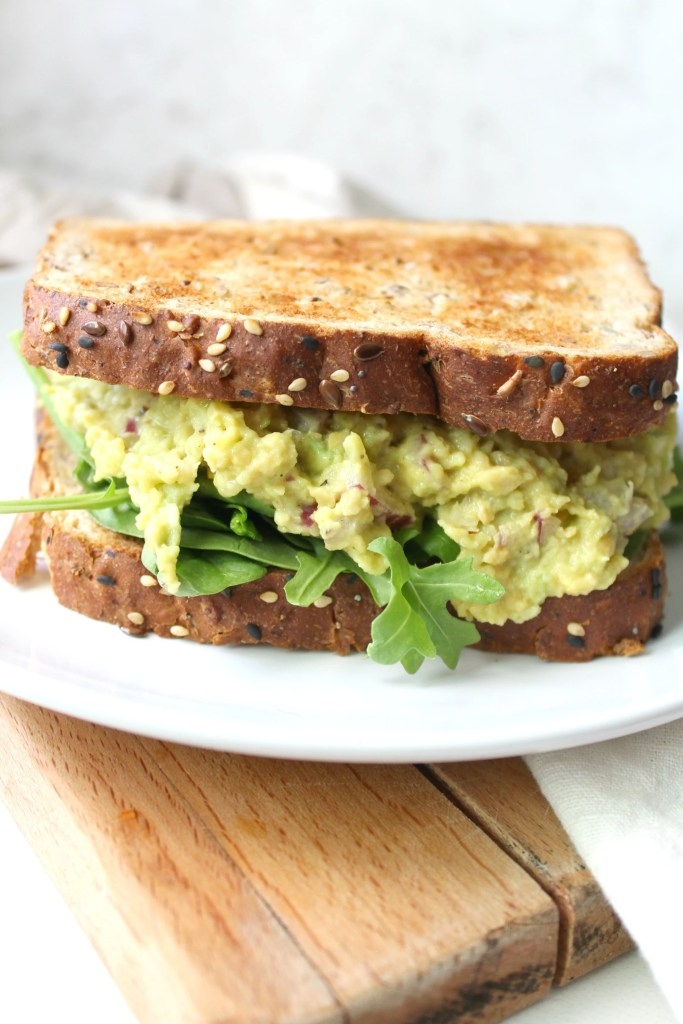 This Green Goddess Sandwich is the ultimate lunch. Packed full of smashed chickpeas, avocado, vegan mayo, red onion and jalapeño | ThisSavoryVegan.com #vegan #healthyvegan