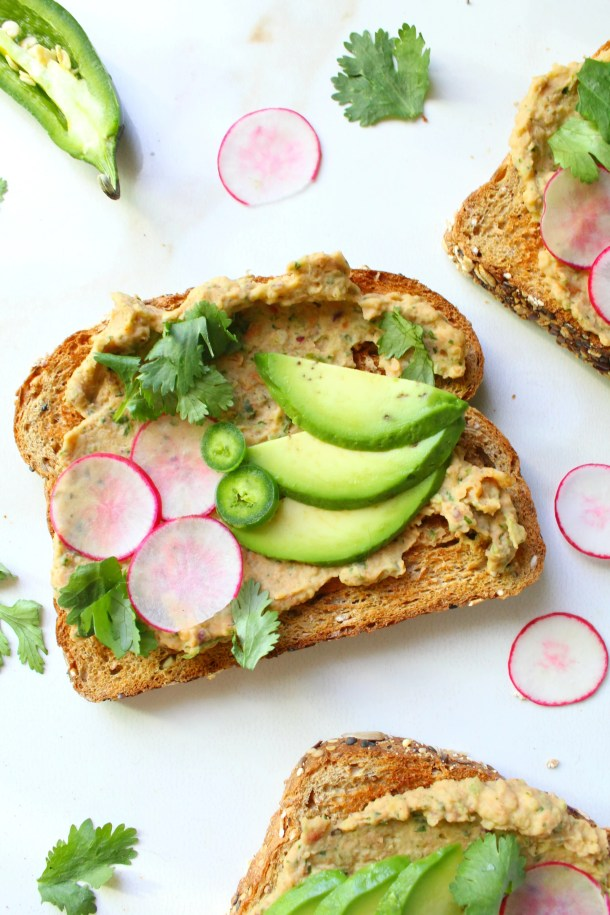 ThisSmashed Bean and Avocado Toast is next level. The perfect healthy vegan snack - packed full of mexican flavors and nutrient-rich ingredients | ThisSavoryVegan.com #vegan #healthyvegan