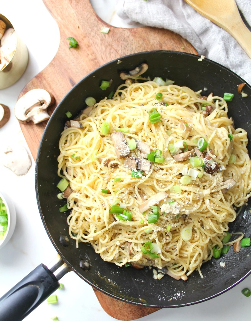 Simple and delicious, these Vegan Mushroom Garlic Parmesan Noodles are a delicious mix of angel hair pasta, sliced mushrooms, fresh garlic and parmesan | ThisSavoryVegan.com #vegan #veganrecipes