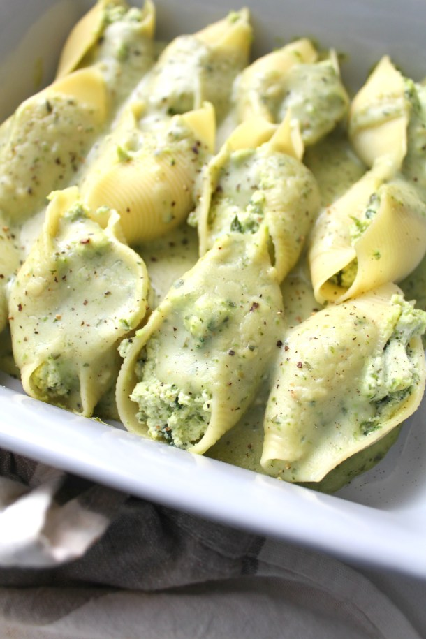 Have a fancy dinner with minimal work - Vegan Ricotta Stuffed Shells with Creamy Pesto. A baked pasta dish that everyone will love | ThisSavoryVegan.com #vegan #veganpasta