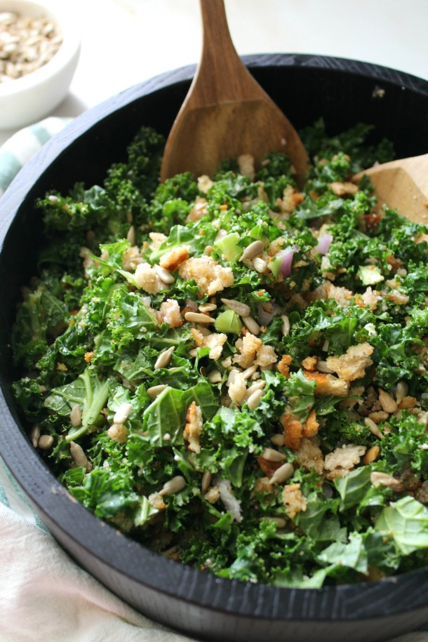 This Toasted Breadcrumb and Vegan Parmesan Kale Salad is what kale salads should always be. Ready in 30 minutes and tossed in a light lemon vinaigrette, this is the perfect side salad for any time of year | ThisSavoryVegan.com