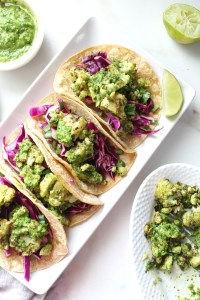 Crispy, roasted cauliflower is combined with bright, fresh chimichurri sauce in corn tortillas with a purple cabbage slaw in these Crispy Chimichurri Cauliflower Tacos. So many great flavors in these vegan beauties | ThisSavoryVegan.com #vegantacos #tacotuesday #veganrecipe