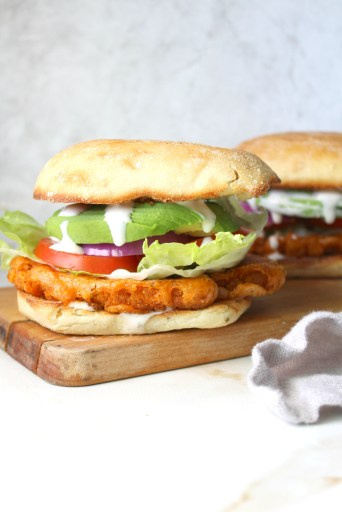 Dripping in flavor, crunch and spice, this is theUltimate Vegan Buffalo Cauliflower Sandwich! Instructions for both baked and fried versions included | ThisSavoryVegan.com #vegansandwiches #buffalocauliflower #veganrecipes